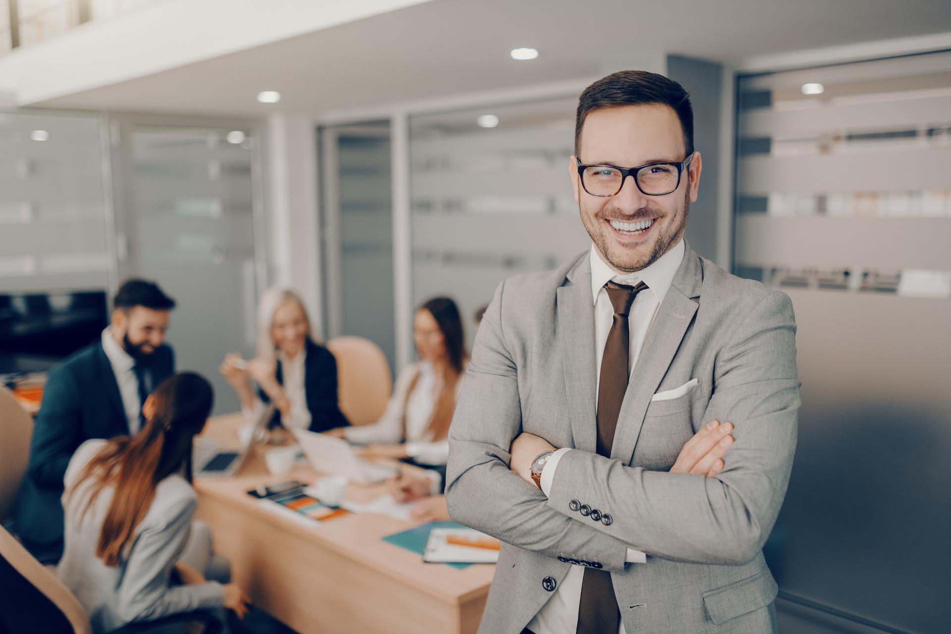 Handsome smiling businessman in formal wear and eyeglasses